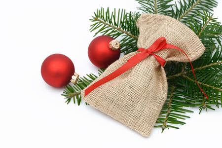 sac: santa sac lying on fir branch with xmas bauble