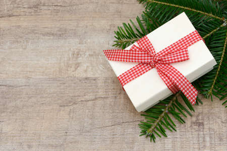 enveloped: Xmas present and fir lying on wood