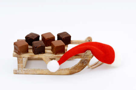 toboggan: domino pieces and santa hat on toboggan