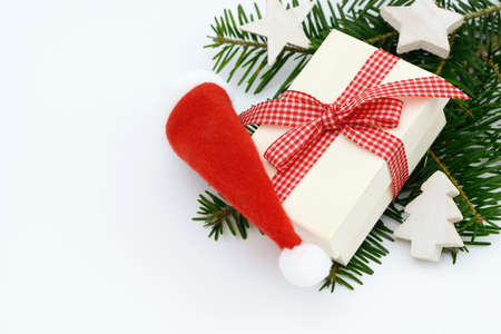 enveloped: Xmas present and Christmas hat Stock Photo