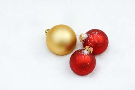 gold ornaments: xmas bauble lying on snow