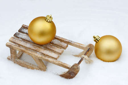 toboggan: xmas bauble on toboggan in snow Stock Photo
