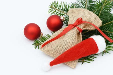 sac: santa sac and Christmas hat lying on fir branch Stock Photo