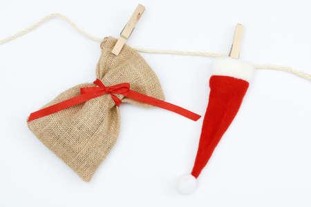 sac: santa sac and xmas hat hanging on a leash
