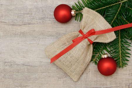 enveloped: santa bag lying on wood