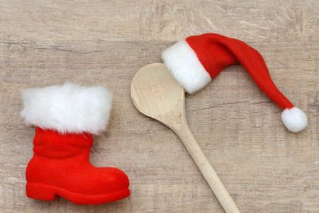 christmas cooking: wooden spoon and santa hat