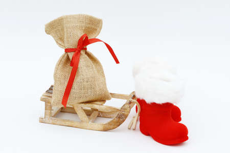 toboggan: santa boots and santa bag lying on toboggan