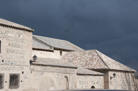sunshines: Church in Toledo with storm coming in the background Stock Photo