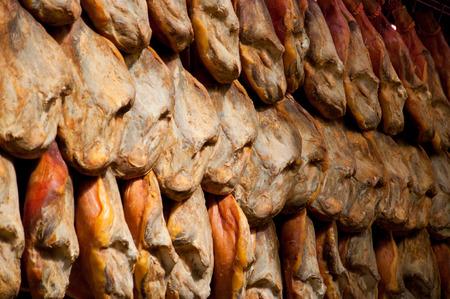 serrano: Aging jamon serrano ham hanging in a market