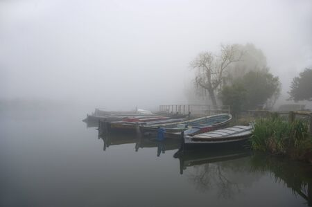 Boats in the fog, Albufera de Valencia. Spain. 免版税图像