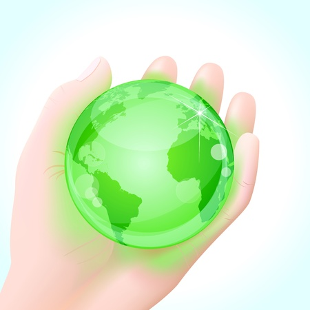 natural resources: Green energy concept. Human hand holding a green glowing planet Earth globe.