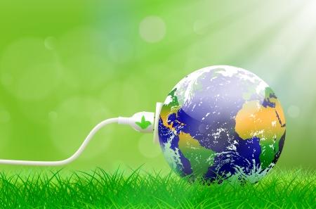 calentamiento global: Concepto de energía verde con el planeta Tierra y el cable de alimentación eléctrica en el exuberante césped