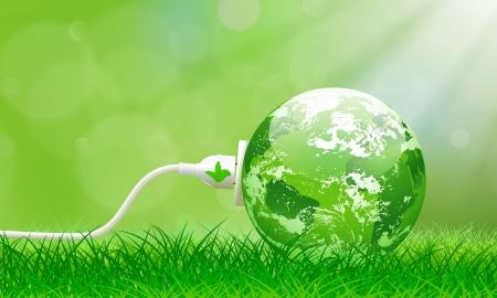 Concepto de energía verde con el planeta Tierra y el cable de alimentación eléctrica en el exuberante césped