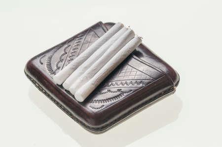 cigarette case: leather cigarette case and rolled cigarettes Stock Photo