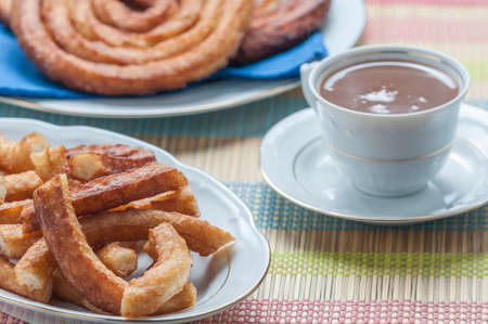 churros with chocolate made by hand at home photo