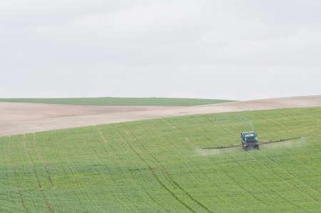 fertilize green meadow with truck