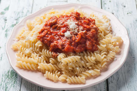 spiral pasta bolognese with grated cheese Stock fotó