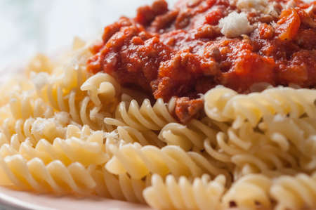 spiral pasta bolognese with grated cheese Stock Photo