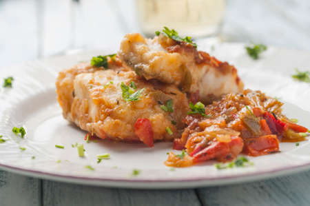Battered cod with almonds and vegetable sauce