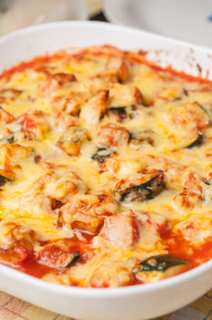 Chicken with zucchini and melted cheese baked photo