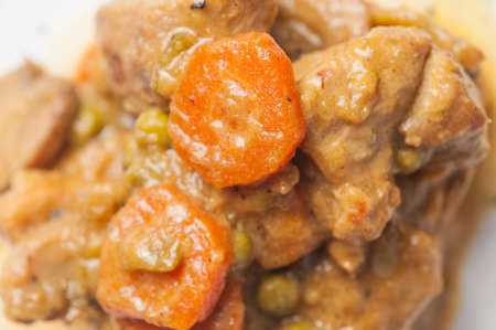 Beef stew with carrots mushrooms photo