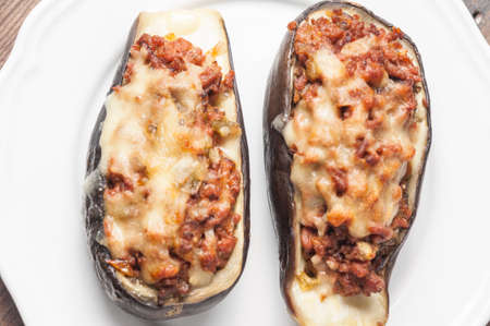 white cheese: eggplant stuffed with meat and vegetables with melted cheese Stock Photo