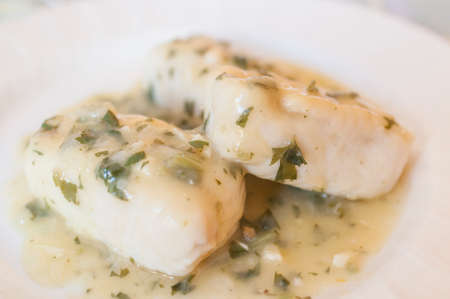 hake: Hake in green sauce with garlic and parsley
