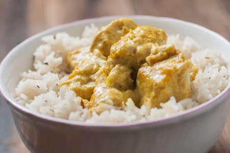 basmati rice: Chicken with curry sauce accompanied by rice basmati Stock Photo