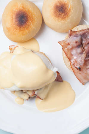 benedict: Poached eggs with bacon and hollandaise sauce on English muffins benedict Stock Photo