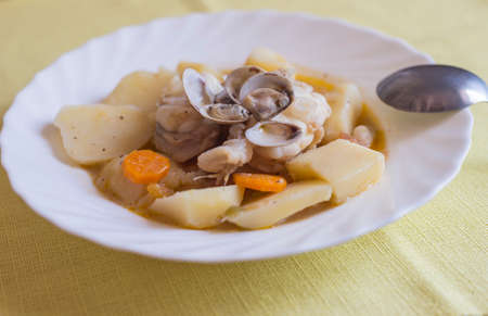 almejas: Fish stew clams and potatoes