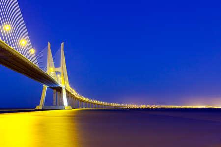 View of Vasco da Gama bridge at dusk. photo