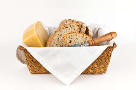bread basket: Traditional bread and cheese isolated on white background.