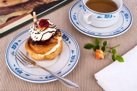 Fresh cream puff with whipped cream and chocolat. Stock Photo - 13549175