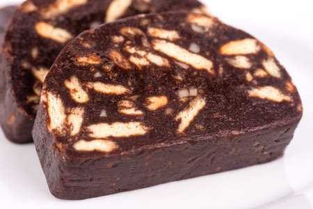 salame: Brown chocolate cake with biscuits and sugar