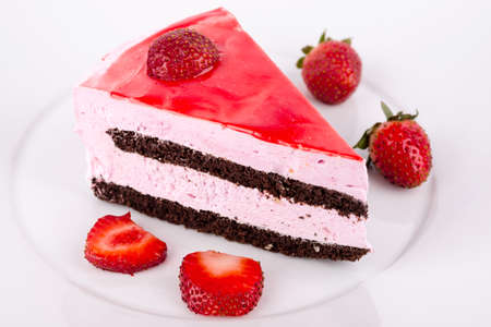 Strawberries and chocolate cake on the plate. photo