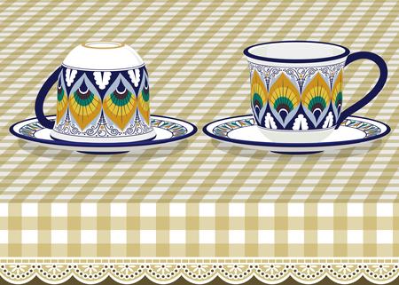 earthenware: Dos tazas de t� con plato sobre mantel a cuadros