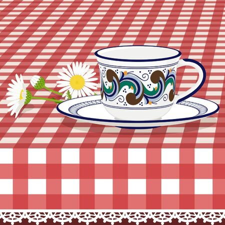 faience: Tea cup on checkered tablecloth with daisies