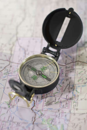 An isolated compass over a topography map Stock Photo - 15373740