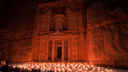 of petra: Treasury facade of Petra illuminated by candles Stock Photo