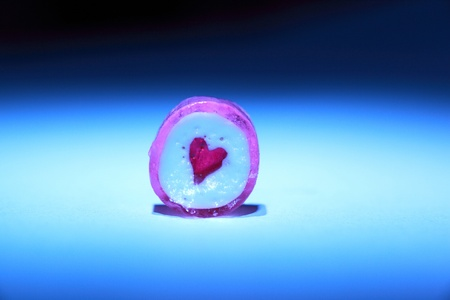 Close up of one candy with a heart in the middle
