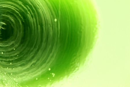 Lime spinning around in mineral water Stock Photo - 16693485