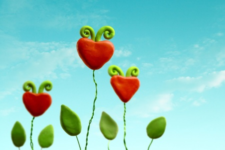 Family of three heart flowers on a blue sky Stock Photo