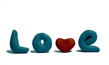 modelled: The word love modelled with plasticine on a white background. Stock Photo