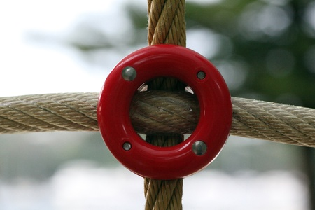Rope connected by a red plastic bolt.