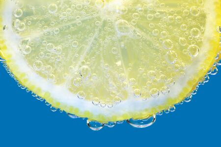 Close up of a slice of lemon in sparkling mineral water