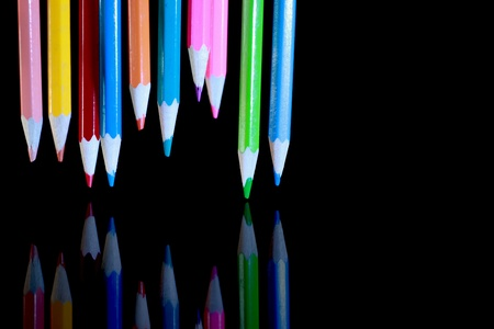 Colored pencils floating on a black background Stock Photo - 17045097