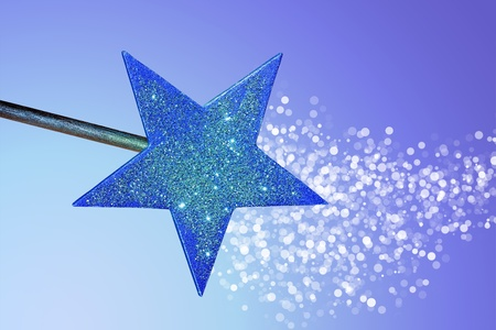 wish: Magic wand casting a spell on a blue background
