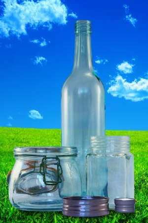 smother: Three empty bottles without lids on on a vintage, grungy landscape background  Stock Photo