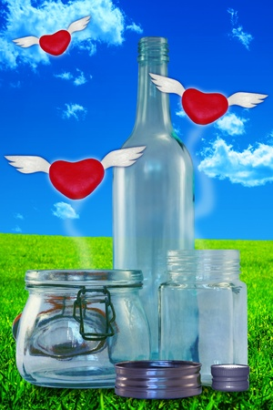 smother: Red hearts with wings escaping from three glass jars on a dreamy landscape background  Stock Photo