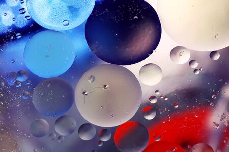 Colored bubbles of oil mixed with water photo
